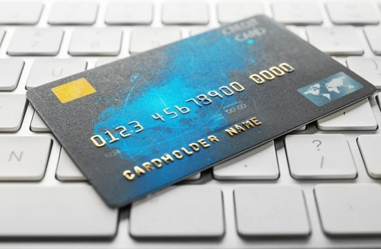 Credit card on computer keyboard, closeup